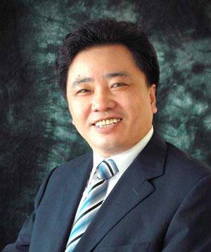 全国人大代表,青岛啤酒董事长金志国